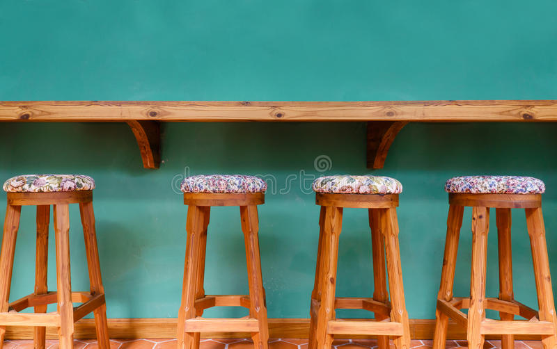 Vintage wooden stool chair on green background. Restaurant royalty free stock images