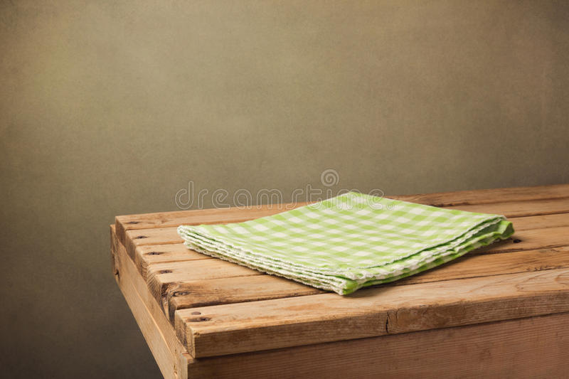 Vintage wooden table with green checked tablecloth. Over grunge background royalty free stock photos