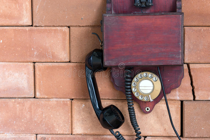 A vintage wooden telephone stock photos