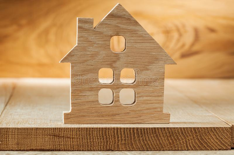 Vintage wooden toy house on wood background stock images