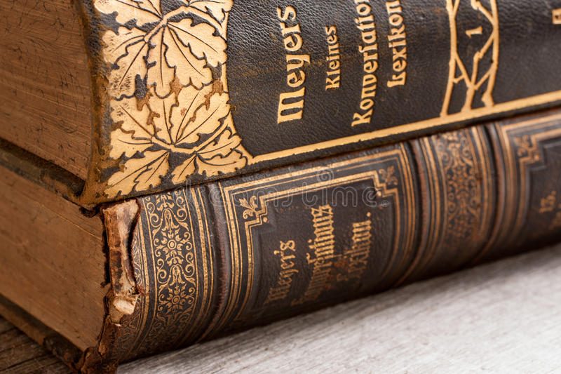 Vintage worn out German books on a wooden table royalty free stock images