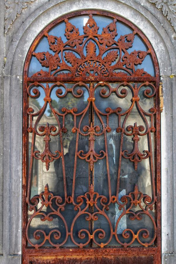 Wrought iron door in cemetery royalty free stock images