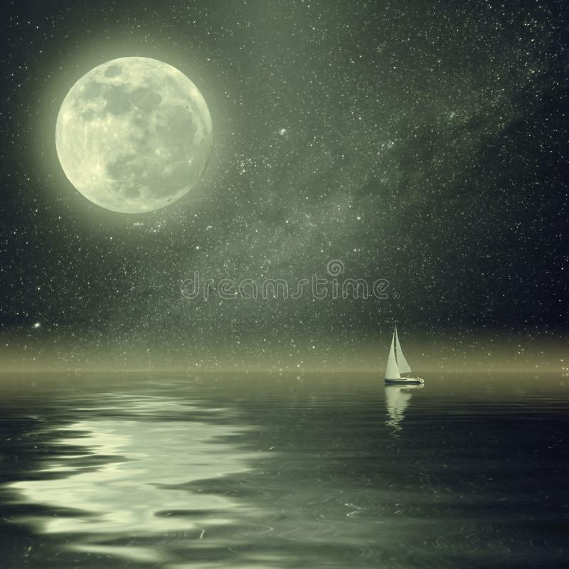 Vintage yacht in ocean with Moon and Stars. Lonely yacht in calm ocean, full moon and stars reflection in water. Vintage landscape with milky way. Film filter stock photos