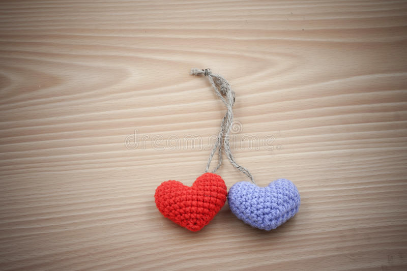 Vintage Yarn hearts on wood stock images