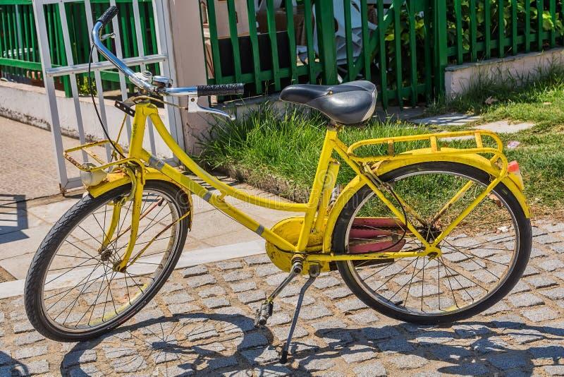 Vintage yellow bicycle. On the beach stock photos