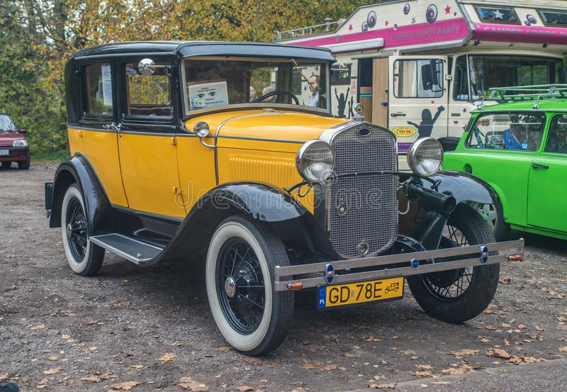 Classic old yellow black Ford A parked stock images