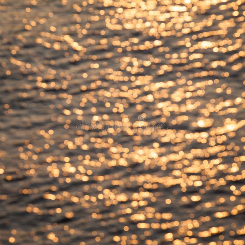 Vintage yellow color water defocused bokeh. Background royalty free stock photo