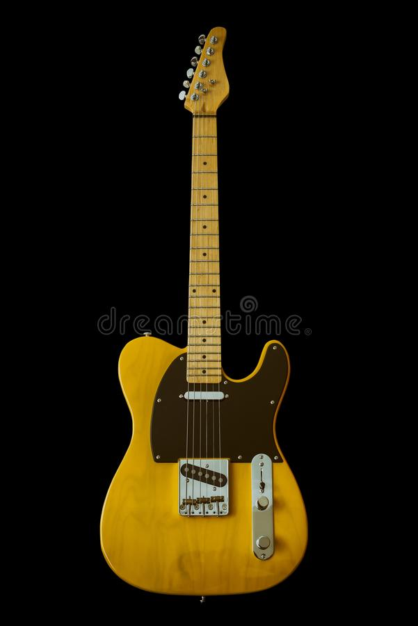 Vintage Yellow Electric Guitar. With Black Pickguard Isolated On Black Background royalty free stock photos
