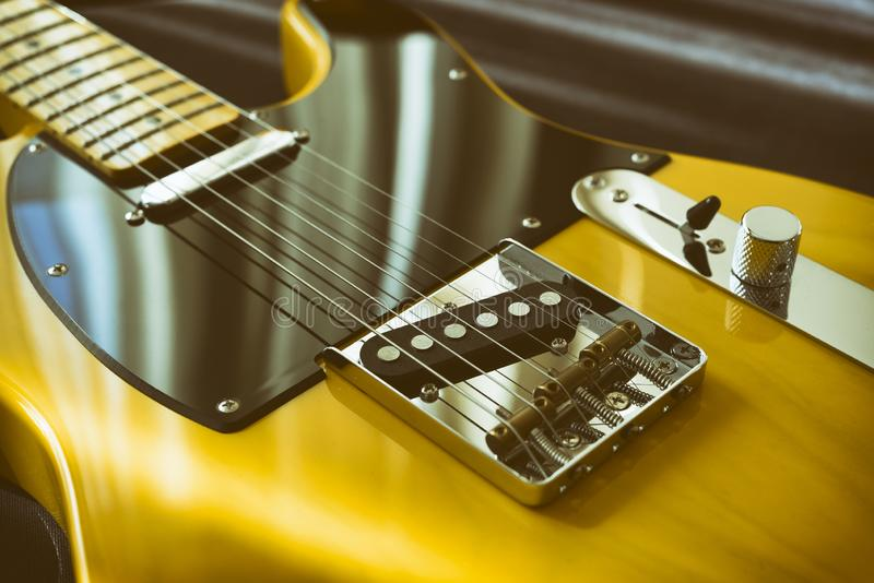 Vintage Yellow Electric Guitar. Close Up Shot Of A Vintage Yellow Electric Guitar With Black Pickguard royalty free stock photo