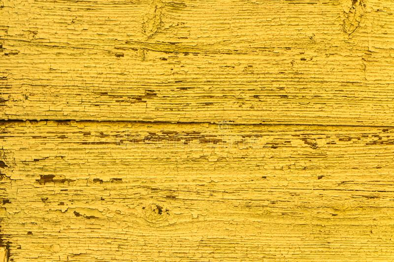 Vintage Yellow Faded Natural  Background. Grunge Old Solid Wood Shabby Peeling Paint Isolated Wall Texture. stock images