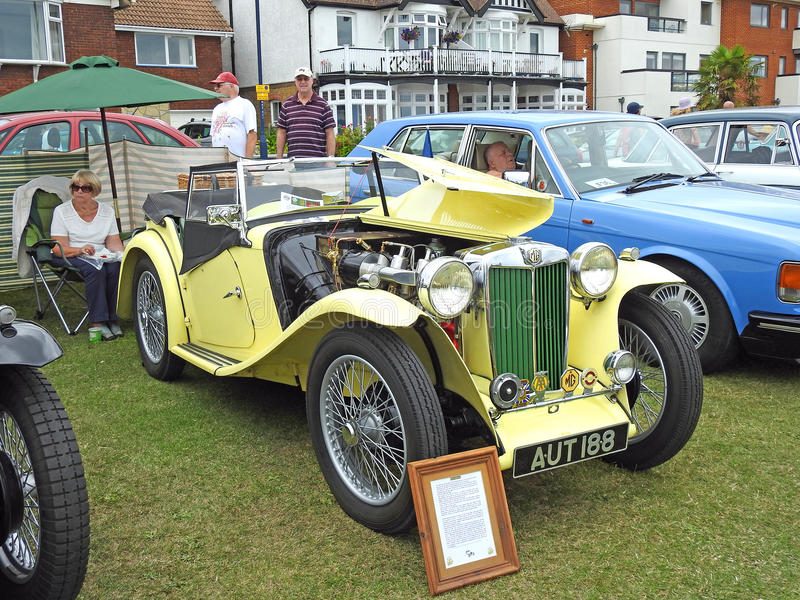 Vintage yellow mg roadster car. Photo of a mg vintage convertible roadster car on display at whitstable car show 16th july 2017 royalty free stock photo