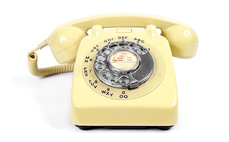Vintage Yellow Rotary Dial Telephone stock photography