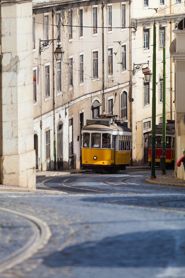 Vintage yellow tramway in Lisbon, Portugal. Bright tram on neutral background building. Tram edit up stock photography