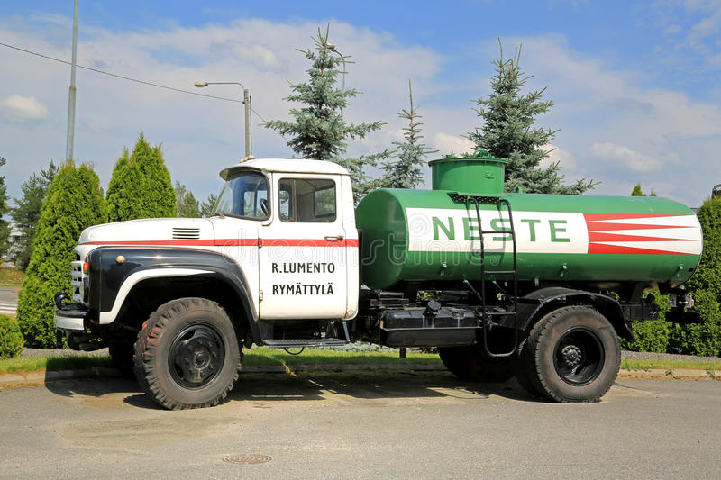 Vintage Zil 130 Tank Truck on a Yard. RAISIO, FINLAND - JULY 13, 2014: Vintage Zil 130 Neste tank truck on a yard. Produced since 1962, mass-produced since 1964 royalty free stock photo