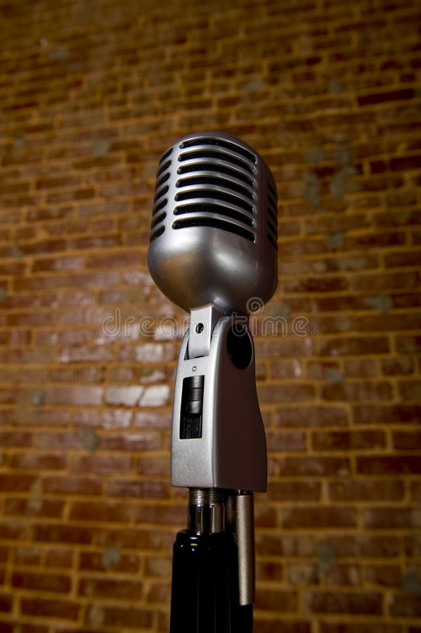 VintageMicrophone In Front Of Brick Wall Royalty Free Stock Image
