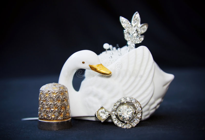 Vintate Sewing Kit With Swan And Silver Thimble Royalty Free Stock Photo