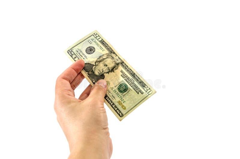 Vinte dólares à disposição no fundo branco foto de stock royalty free
