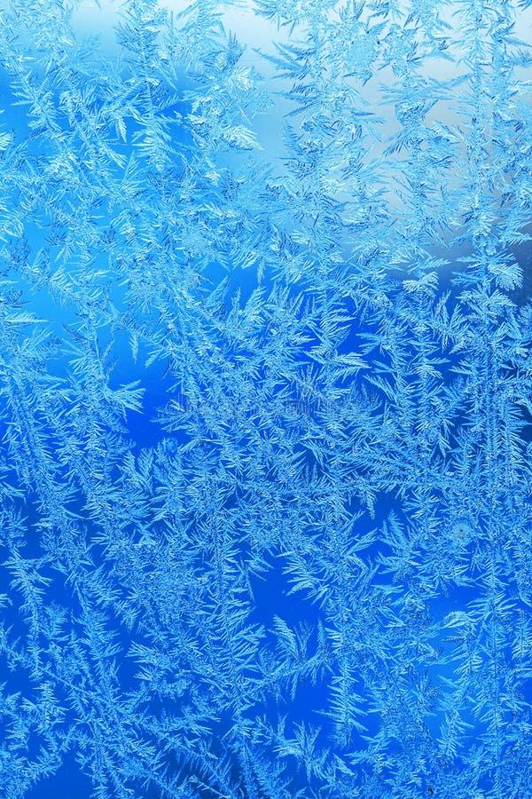 Vinterisfrost, fryst bakgrund frostad textur för fönsterexponeringsglas arkivbilder