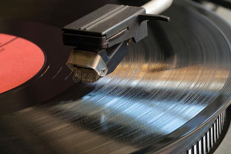 Vinyl analog record player cartridge. Vinyl analog record player cartridge and LP close up. Deep focus royalty free stock images