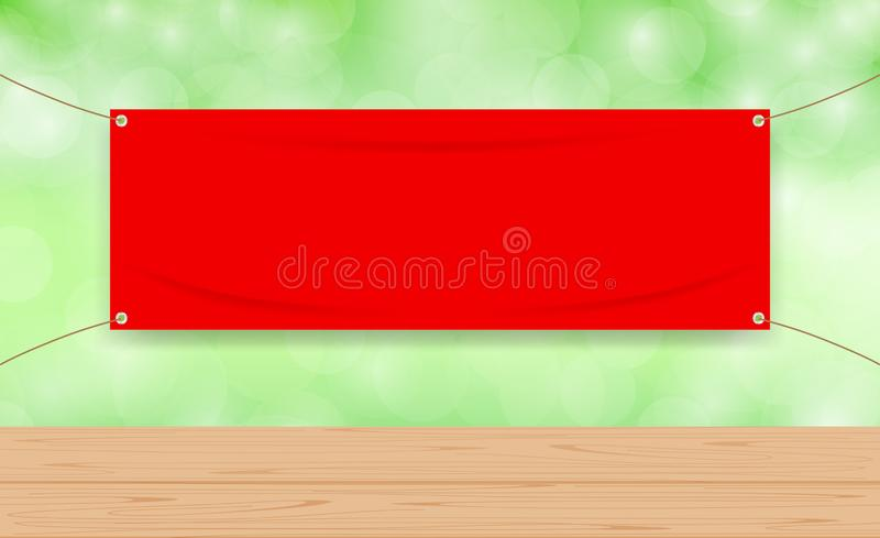 Vinyl blank red on green bokeh background and wood plank table, mock up textile fabric empty for banner advertising stand hanging stock illustration