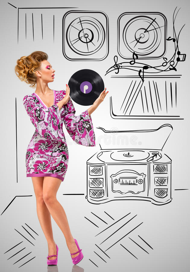 Vinyl collection. Colorful photo of a fashionable hippie homemaker holding a purple LP microgroove vinyl record in her hands on grey sketchy background of a stock image
