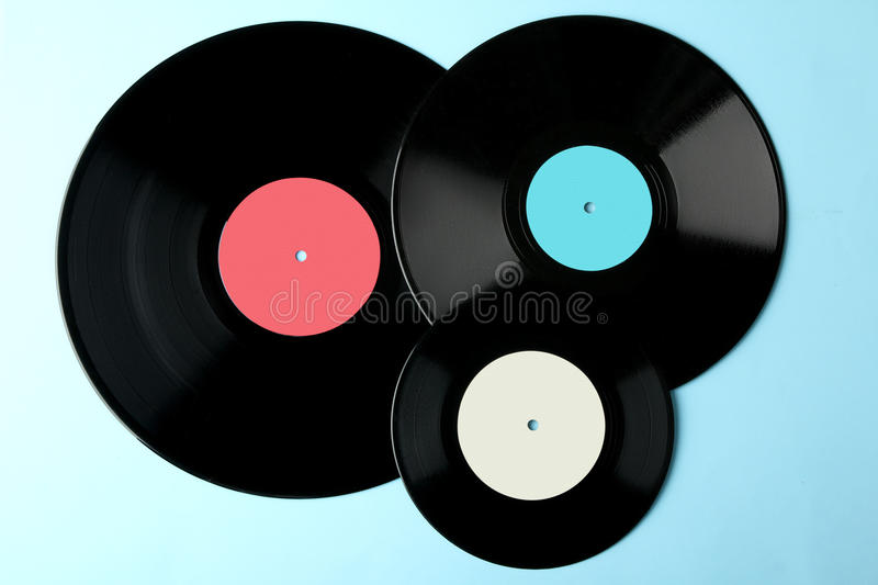 Vinyl. Colored vinyl plate on blue wooden background royalty free stock photo