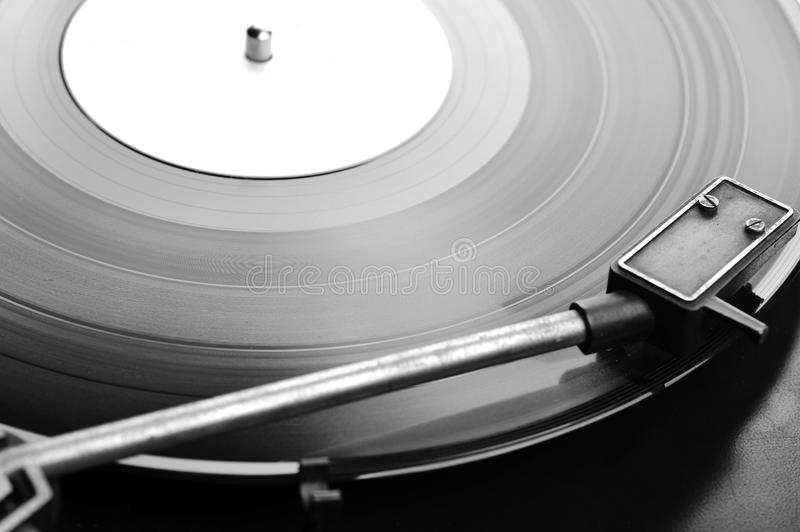 Vinyl disc. Vinyl record spinning on turntable close up royalty free stock image