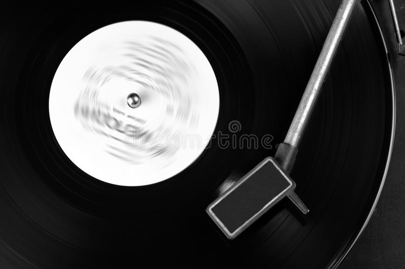 Vinyl disc. Vinyl record spinning on turntable close up stock photography