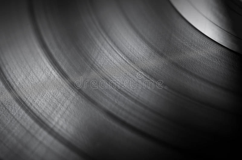 Vinyl disc close up background. Detailed vinyl LP close up background with shallow depth of field stock photography