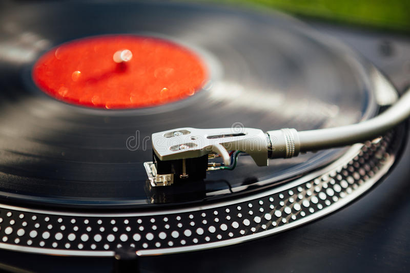 Vinyl disc playing on turntable stock image