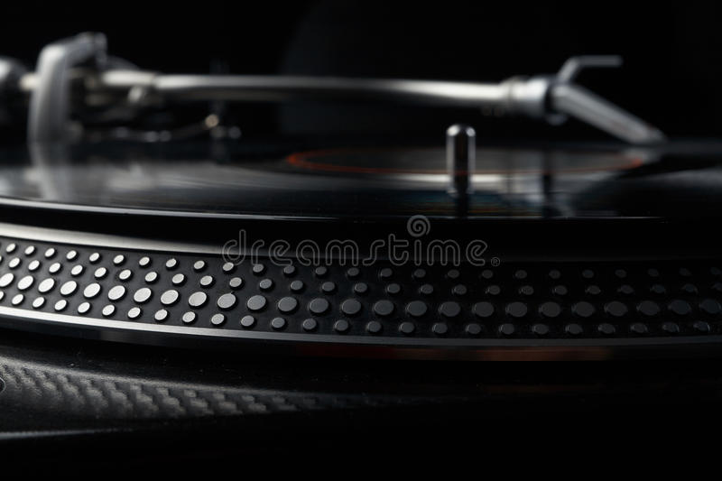 Vinyl disk player. Close up photo of vinyl disk player royalty free stock images