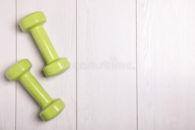 Vinyl dumbbells and space for text stock photography