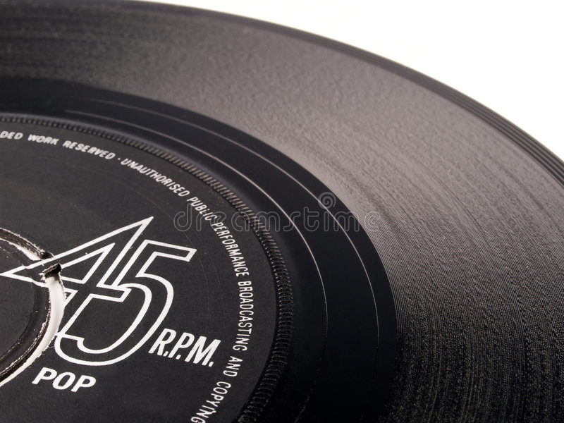 vinyl för 45 pop registrerad r/min. arkivbilder