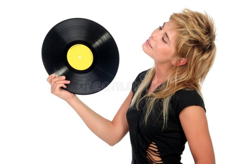 vinyl för flickaholdingregister royaltyfri foto