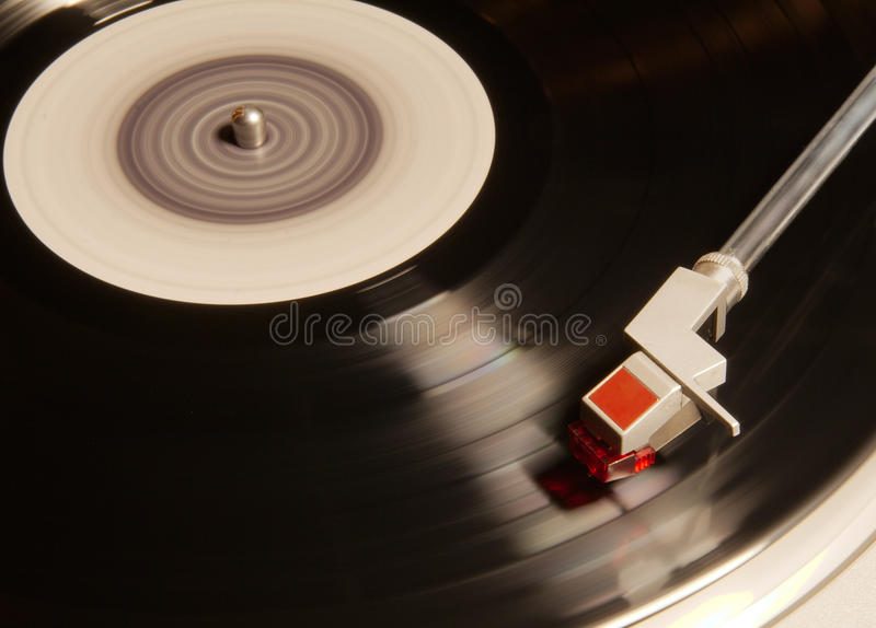 Vinyl player. Old vinyl player in motion royalty free stock photography
