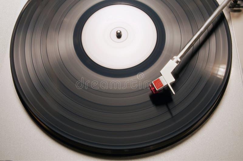 Vinyl player. Vintage vinyl player in motion stock images