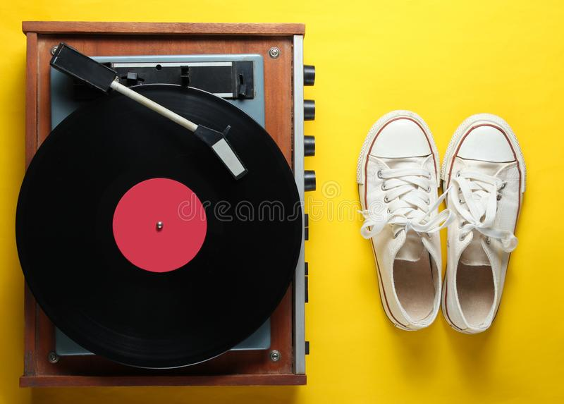 Vinyl player, old sneakers royalty free stock photos