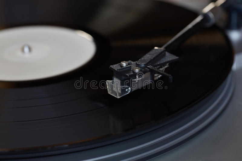 Vinyl player. The rotating disk. Head close-up. Vinyl player. The rotating disk royalty free stock images