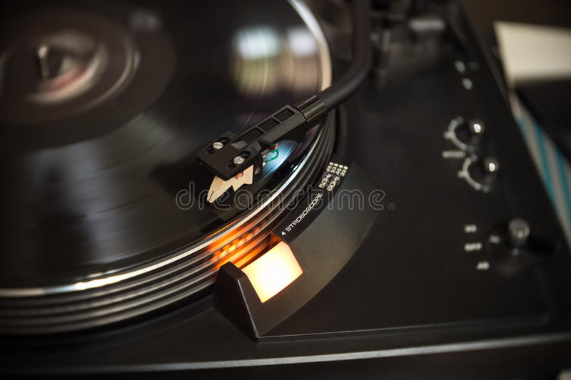 Vinyl player. Turntable vinyl record player with spinning black lp disc stock photos