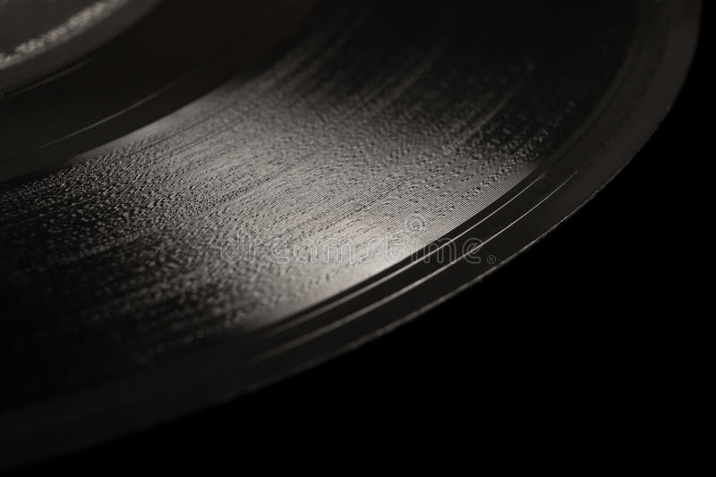 Vinyl record. Vintage vinyl record on black background royalty free stock photography