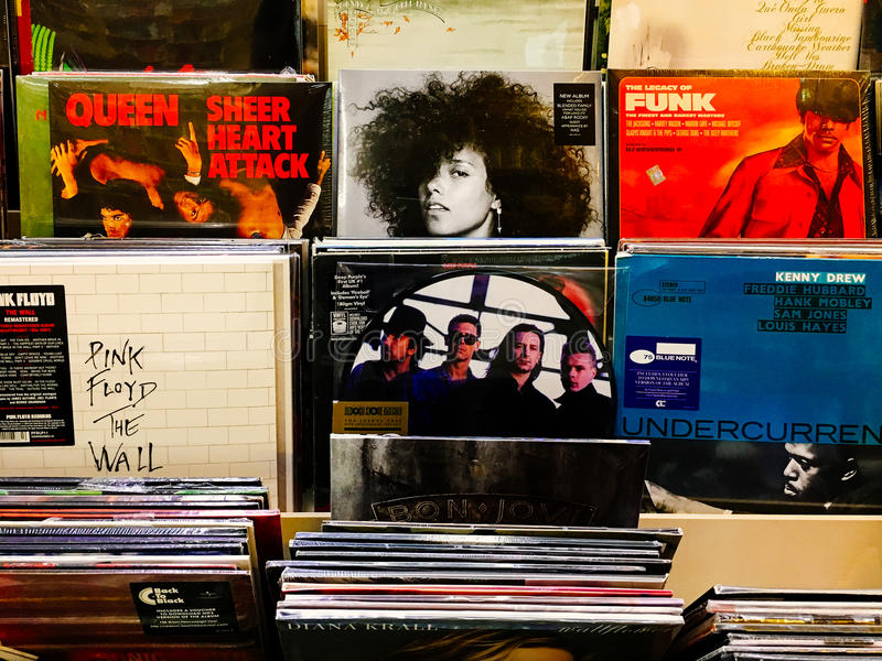 Vinyl Record Cases Of Famous Music Bands For Sale In Music Store royalty free stock photo