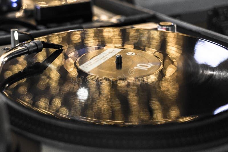 Vinyl record closeup. Vinyl record player. DJ mixing console. Needle on the music track. Sound recording studio. Party poster. Vinyl DJ. Music on vintage media royalty free stock image