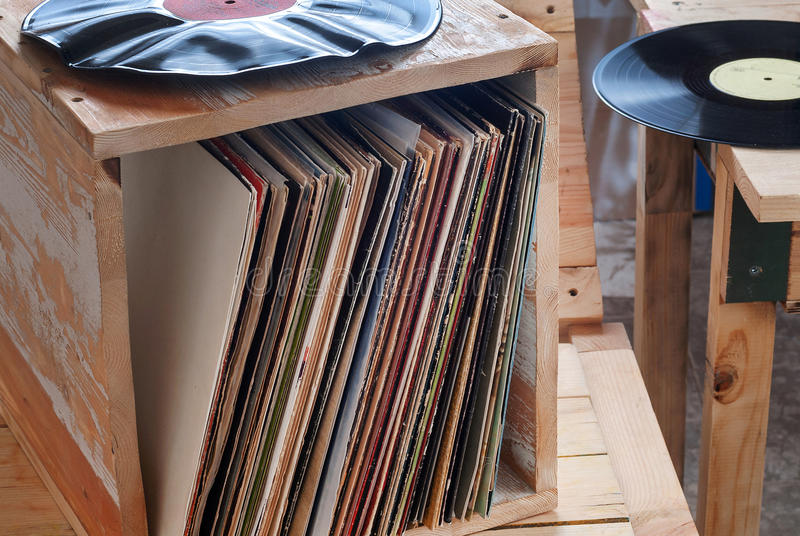 Vinyl record with copy space in front of a collection albums dummy titles, vintage process royalty free stock photography