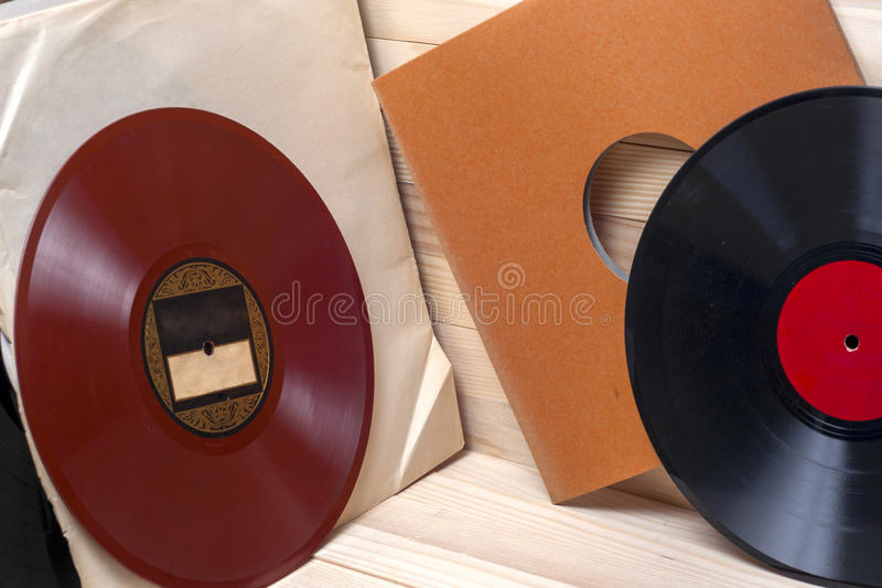 Vinyl record. Copy space for text. Vinyl record in front of a collection of albums, vintage process. Copy space for text royalty free stock photos