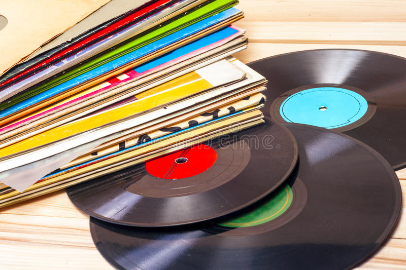 Vinyl record. Copy space for text. Vinyl record in front of a collection of albums, vintage process. Copy space for text royalty free stock photo
