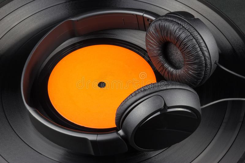 Vinyl Record and Headphones on Black Background royalty free stock image