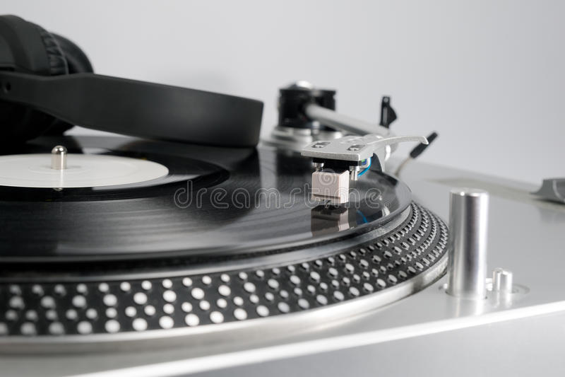 Vinyl record and headphones on the player royalty free stock photo