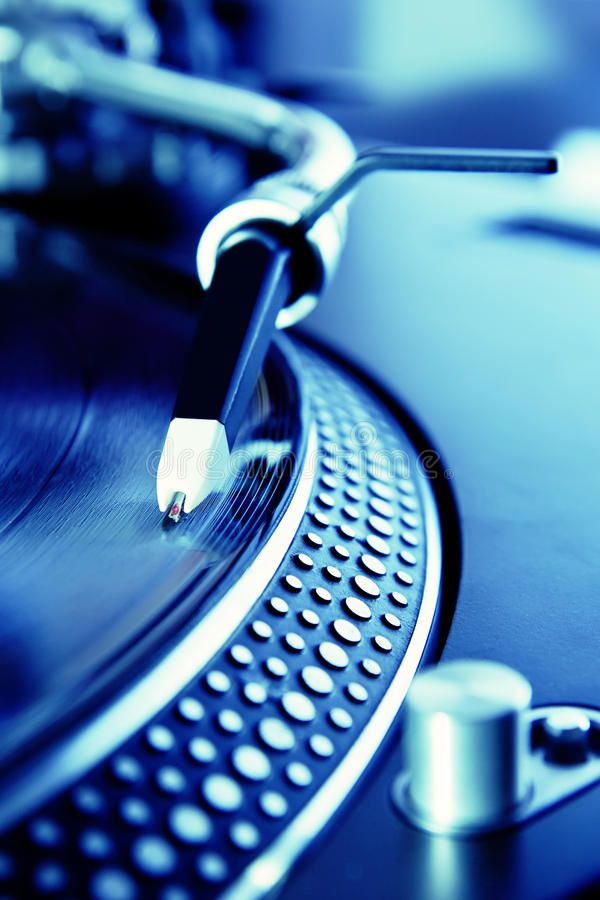 Vinyl record player spinning the disc. Turntable playing the vinyl record with music stock photo