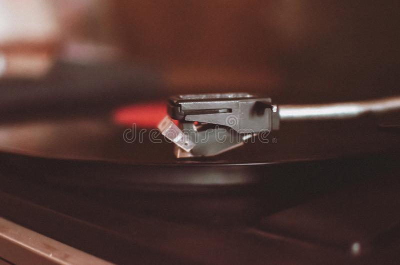 Vinyl record player on a sunset background over the city lights. Sound technology for DJs to mix and play music. Black vinyl. Record. 1980 vintage vinyl wood stock photography