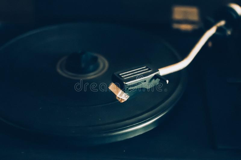 Vinyl record player on a sunset background over the city lights. Sound technology for DJs to mix and play music. Black vinyl. Record. 1980 vintage vinyl wood stock image